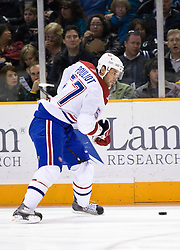 March 4, 2010; San Jose, CA, USA; Montreal Canadiens left wing Benoit Pouliot (57) shoots against the San Jose Sharks during the first period at HP Pavilion.  San Jose defeated Montreal 3-2. Mandatory Credit: Jason O. Watson / US PRESSWIRE