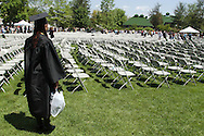 Middletown - A graduate looks at rows of empty chairs after the 58th commencement at Orange County Community College on May 17, 2008.