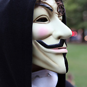 A protester wears a mask to conceal his face during an Occupy Orlando public demonstration in support of Occupy Wall Street gatherings across the country, at the Orange County History Center on Wednesday, October 5, 2011 in Orlando, Florida. (AP Photo/Alex Menendez)