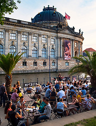 Late summer afternoon at Strandbad Mitte outdoor beach bar beside Spree River on Museum Island (Museumsinsel) in Mitte, Berlin, Germany