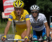 FRANCE 23rd JULY 2007: Mikael Rassmussen (Rabobank) leads Alberto Contador (Discovery Channel) out of Cazeaux de Larboust with just under 20 km to go on stage 15.  The stage started in Foix and ended at Loudenvielle.