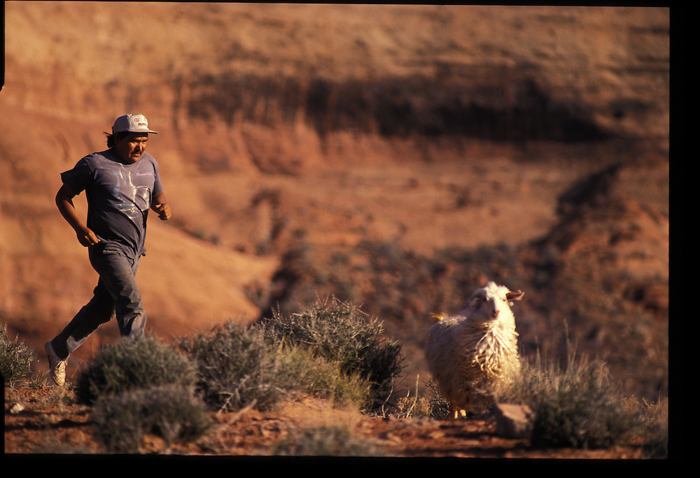 """As the son of a minister, Eugene Chrr Jr. has found that Christianity often clashes with tribal customs -- for example, through """"mutton hunger.""""  Oljeto, Utah  1993"""