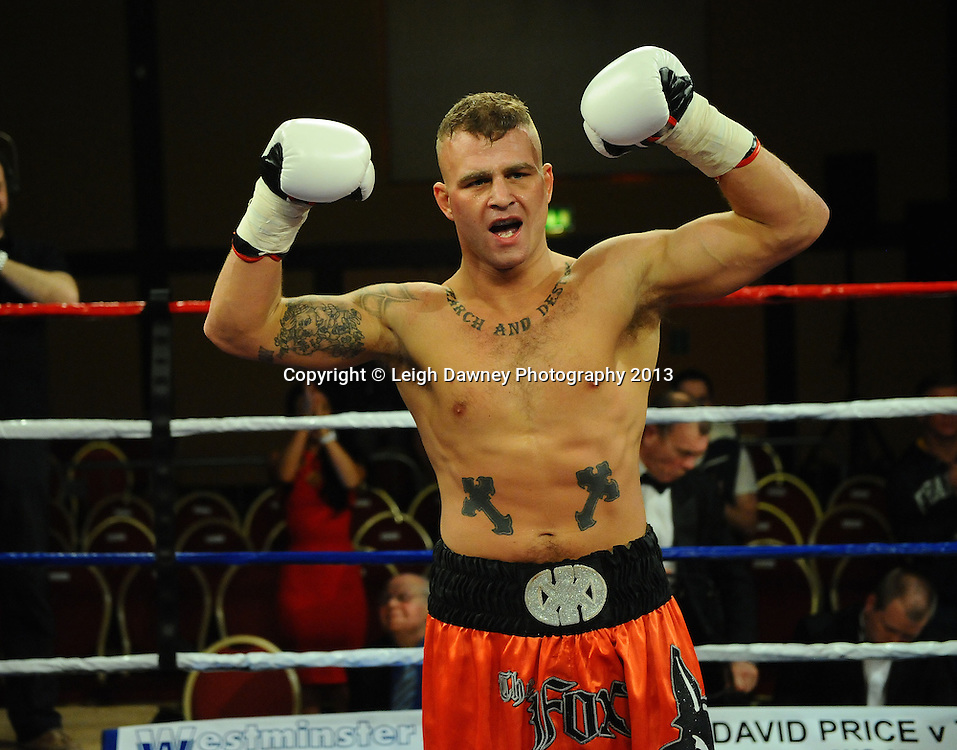 Gary Fox (orange shorts) defeats Mark McKray in a 4x3 Light Welterweight contest at Rainton Meadows Arena, Houghton Le Spring, Tyne & Wear, UK. 15th February 2013. Frank Maloney Promotions. © Leigh Dawney 2013