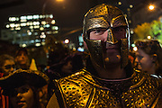 New York, NY, October 31, 2013. A man wearing a helmet like a Roman legionnaire's in New York's Greenwich Village Halloween Parade.