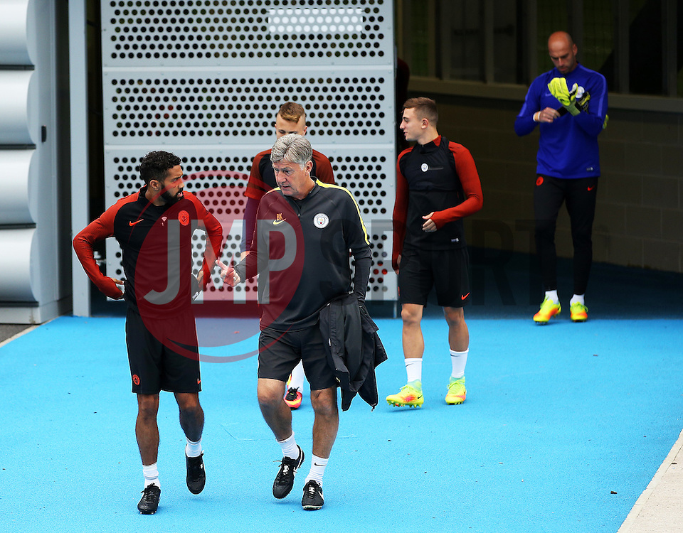 Gael Clichy of Manchester City talks with coach Brian Kidd - Mandatory by-line: Matt McNulty/JMP - 12/09/2016 - FOOTBALL - Manchester City - Training session ahead of Champions League Group C match against Borussia Monchengladbach