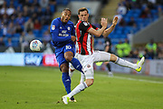 Kenneth Zohore of Cardiff City and Richard Stearman of Sheffield United during the EFL Sky Bet Championship match between Cardiff City and Sheffield Utd at the Cardiff City Stadium, Cardiff, Wales on 15 August 2017. Photo by Andrew Lewis.