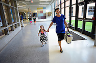 WARMINSTER, PA - SEPTEMBER 3: Megan Muladze, 5 holds her mother Nadia Muladze's hand as they arrive for the first day of school September 3, 2013 at the new McDonald Elementary School in Warminster, Pennsylvania. (Photo by William Thomas Cain/Freelance)