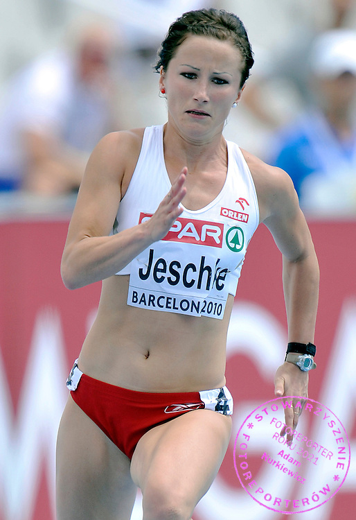 MARTA JESCHKE (POLAND) COMPETES IN THE WOMEN'S 200 METERS QUALIFICATION DURING THE 2010 EUROPEAN ATHLETICS CHAMPIONSHIPS AT OLYMPIC STADIUM IN BARCELONA, SPAIN...SPAIN , BARCELONA , JULY 30, 2010..( PHOTO BY ADAM NURKIEWICZ / MEDIASPORT )..PICTURE ALSO AVAIBLE IN RAW OR TIFF FORMAT ON SPECIAL REQUEST.