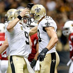 Sep 22, 2013; New Orleans, LA, USA; New Orleans Saints quarterback Drew Brees (9) celebrates with tight end Jimmy Graham (80) after a touchdown against the Arizona Cardinals during the second half of a game at Mercedes-Benz Superdome. The Saints defeated the Cardinals 31-7. Mandatory Credit: Derick E. Hingle-USA TODAY Sports