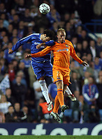 Photo: Paul Thomas.<br /> Chelsea v Barcelona. UEFA Champions League, Group A. 18/10/2006.<br /> <br /> Eidur Gudjohnson (R) of Baarcelona and Ricardo Carvalho go for the ball.