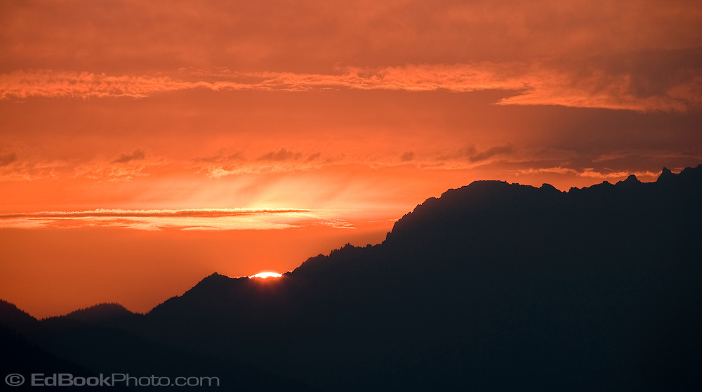 Olympic Mountains Red Sunset from the Kitsap Peninsula in Puget Sound, Washington, USA