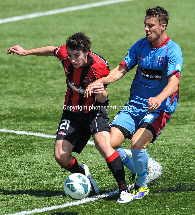 Shawn O'BRIEN of Canterbury United is tackled by Aaron JONES of Hawkes Bay in the ASB Premiership, Canterbury v Hawkes Bay, 16 February 2014. Photo:John Davidson/photosport.co.nz