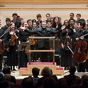 November 25, 2012 - New York, NY : Music director Joshua Gersen (with outstretched arms) and the New York Youth Symphony take a bow after performing in Carnegie Hall's Isaac Stern Auditorium on Sunday afternoon. CREDIT: Karsten Moran for The New York Times
