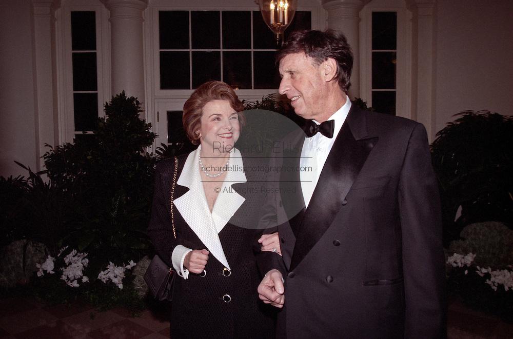 Senator Dianne Feinstein with husband investment banker Richard Blum arrive for the State Dinner for Argentine President Carlos Menem January 11, 1999 at the White House.