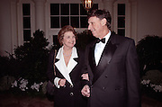 Senator Dianne Feinstein with husband investment banker Richard Blum arrive for the State Dinner for Argentine President Carlos Menem January 11, 1999 at the White House.