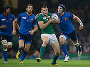 Cardiff, Wales, Great Britain, left to right, Thierry DUSAUTOIR, Remi TALES, Robbie HENSHAW, with the ball, and Bernard LE ROUX closing in for the tackle, during the Pool D game, France vs Ireland.  2015 Rugby World Cup,  Venue, Millennium Stadium, Cardiff. Wales   Sunday  11/10/2015.   [Mandatory Credit; Peter Spurrier/Intersport-images]