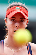 Paris, France - 2017 June 03: Alize Cornet from France  looks at the ball during women's single match third round  during tennis Grand Slam tournament The French Open 2017 (also called Roland Garros) at Stade Roland Garros on June 03, 2017 in Paris, France.<br /> <br /> Mandatory credit:<br /> Photo by © Adam Nurkiewicz<br /> <br /> Adam Nurkiewicz declares that he has no rights to the image of people at the photographs of his authorship.<br /> <br /> Picture also available in RAW (NEF) or TIFF format on special request.<br /> <br /> Any editorial, commercial or promotional use requires written permission from the author of image.