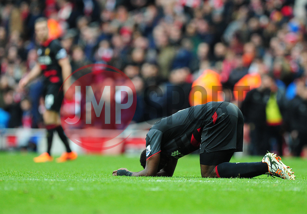 Kolo Toure of Liverpool looks dejected at full time. - Photo mandatory by-line: Alex James/JMP - Mobile: 07966 386802 - 04/04/2015 - SPORT - Football - London - Emirates Stadium - Arsenal v Liverpool - Barclays Premier League