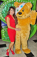 LONDON - November 14: Lizzie Cundy & Pudsey at Children in Need POP goes the Musical: Shrek The Musical (Photo by Brett D. Cove)