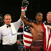 TAMPA, FL - FEBRUARY 28:  Clarence Booth celebrates his victory over Osenohad Vazquez during the SoloBoxeo Tecate boxing match at the University of South Florida Sundome on February 28, 2015 in Tampa, Florida. Booth won the bout by knockout.  (Photo by Alex Menendez/Getty Images) *** Local Caption *** Clarence Booth; Osenohad Vazquez