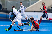 Hampstead & Westminster's Steve Kelly tackles Zach Wallace of Surbiton. Hampstead & Westminster v Surbiton - Men's Hockey League Final, Lee Valley Hockey & Tennis Centre, London, UK on 29 April 2018. Photo: Simon Parker