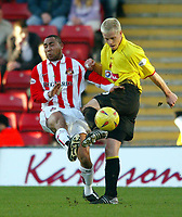 Photo: Scott Heavey.<br />Watford v Sunderland. Nationwide Division One. 07/02/2004.<br />Jeff Whitley (L) prepares to block the cross from Heidar Helguson