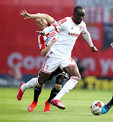 Middlesbrough's Albert Adomah gets past Brentford's Alex Pritchard - Photo mandatory by-line: Robbie Stephenson/JMP - Mobile: 07966 386802 - 08/05/2015 - SPORT - Football - Brentford - Griffin Park - Brentford v Middlesbrough - Sky Bet Championship