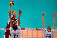 (L) Jakub Jarosz from Poland attacks against Earvin Ngapeth and Kevin Le Roux both from France during the 2013 CEV VELUX Volleyball European Championship match between Poland and France at Ergo Arena in Gdansk on September 21, 2013.<br /> <br /> Poland, Gdansk, September 21, 2013<br /> <br /> Picture also available in RAW (NEF) or TIFF format on special request.<br /> <br /> For editorial use only. Any commercial or promotional use requires permission.<br /> <br /> Mandatory credit:<br /> Photo by © Adam Nurkiewicz / Mediasport
