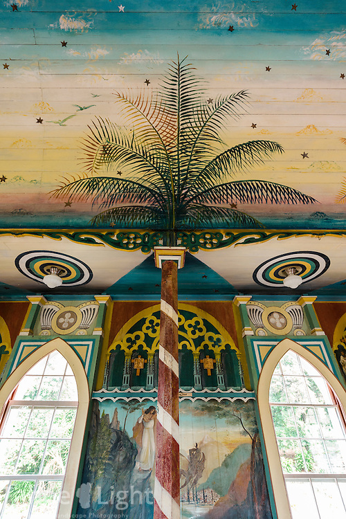 St. Benedict's Catholic Church near Honaunau, the more famous of Hawaii's two painted churches. St. Benedict's dates back to between 1899 an d1904. Father John Velge painted the myriad frescos on the walls and roof and local volunteers lovingly maintain it.