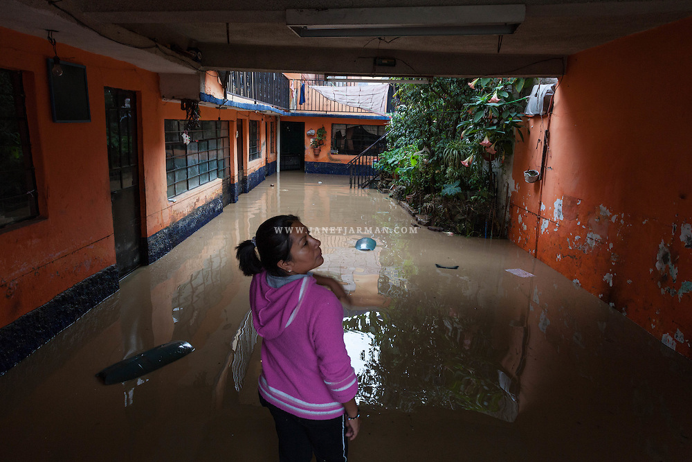 Rosario Martinez, 37, attempts to remove water from her apartment, flooded after torrential rains caused an open drainage canal to break and propel raw sewage into streets and homes in Colonia Ampliación Emiliano Zapata. The low-lying area is one of the most flood-prone areas of the Mexico City Metropolitan Zone (MCMZ).