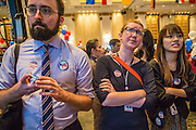 07 NOVEMBER 2012 - BANGKOK, THAILAND:  COLIN CHENEY, left, MARY CONGER and NITHIDA LEEDHIRAKUL watch as US election results are posted at the US Embassy's election watch party in Bangkok. They all supported President Obama's reelection. US President Barack Obama won a second term Tuesday when he defeated Republican Mitt Romney. Preliminary tallies gave the President more than 300 electoral votes, well over the 270 needed to win. The election in the United States was closely watched in Thailand, which historically has very close ties with the United States. The American Embassy in Bangkok sponsored an election watching event which drew thousands to a downtown Bangkok hotel. American Democrats in Bangkok had their own election watch party at a restaurant in Bangkok.      PHOTO BY JACK KURTZ