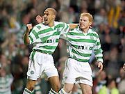 Henrik Larsson celebrates with Neil Lennon. UEFA Cup Quarter Final, Celtic Park, Glasgow, Scotland, March 13th 2003.