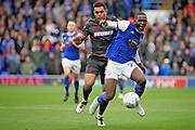 Ipswich Town defender Aristote Nsiala (22)  is fouled by Bolton Wanderers forward Josh Magennis (28) during the EFL Sky Bet Championship match between Ipswich Town and Bolton Wanderers at Portman Road, Ipswich, England on 22 September 2018.