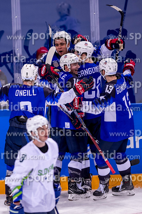 GANGNEUNG, SOUTH KOREA - FEBRUARY 14:  forward Jordan Greenway #18 of the United States, defenseman Bobby Sanguinetti #22 of the United States during Ice Hockey match between Slovenia and USA in the Men's Ice Hockey Preliminary Round Group B at Gangneung Hockey Centre on February 14, 2018 in Gangneung, South Korea. Photo by Ronald Hoogendoorn / Sportida
