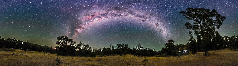 A 360&deg; nightscape panorama of the Milky Way from Carina (at right) to Scutum (at left) arching over the paddock next to the Tibuc Gardens Cottage near Coonabarabran, NSW, Australia, on April 12, 2016. The Dark Emu is visible in its entirety, from the head in Crux at right to his feet in Scutum at left. Scorpius with Mars and Saturn are at top left. Some green airglow tints the horizon. The ground is illuminated only by starlight.<br /> <br /> This is a stitch of 8 panels, each 2.5-minute exposures, all tracked on the iOptron Sky Tracker, with the 15mm full-frame fish eye lens (in portrait orientation) at f/2.8 and filter-modified Canon 5D MkII at ISO 3200. The sky is not trailed but the tracking has blurred the ground slightly. Stitched in PTGui software. The original is 13,800 x 3,800 pixels.