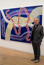 © Licensed to London News Pictures. 15/12/2011. London, UK. Historian and broadcaster, Simon Schama with Marta Marcé's 'untitled (MM 733)' painting which belongs to Cabinet Office in London, seen at the Government Art Collection: Selected by Simon Schama: Travelling Light at the Whitechapel Gallery. Photo credit : James Gourley/LNP