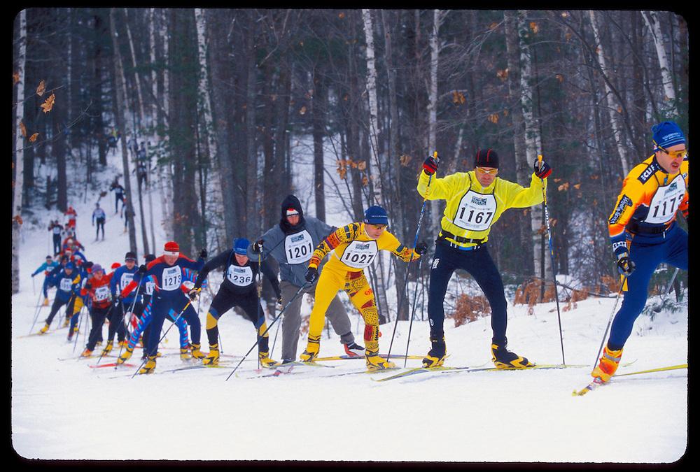 Skiers compete in the Noquemanon Ski Marathon cross country Nordic ski race from Ishpeming to Marquette Michigan.
