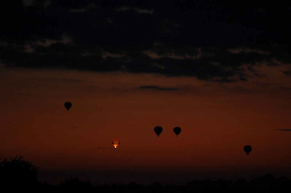 Balloons launch just before daybreak during the Hall of Fame Balloon Fest held at the Stark Campus of Kent State University.<br /> <br /> June 2008<br /> Photo by Bob Christy<br /> horizontal, stark, regional, balloon, summer