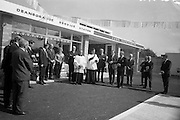 09/08/1967<br /> 08/09/1967<br /> 09 August 1967<br /> Opening of new Esso Service Station at Dean's Grange, Dublin. The site was originally a sculptures yard was a 2-bay service station with the latest equipment. It was to be a 24 hours station and a 5-minute Car Wash and Electronic Tuning was available.  Image shows Rev. Fr. J. Mahon, C.C. Foxrock, blessing the station.