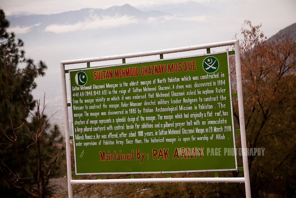 A sign posted by the Pakistan Army is seen on the path to the in the Swat Valley, on February 12, 2011, outside Mingora, Pakistan. The text does not reference the creation of the building as having its origins in the Kingdom of Gandhara, due to its Bhuddist roots. The monastery was converted into a mosque in 1048 A.D. and has since been known as the Ghaznavi Mosque. The Kingdom of Gandhara lasted from early 1st millennium BC to the 11th century AD, and was located in northern Pakistan and eastern Afghanistan. (Photo by Warrick Page)