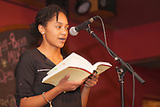 "Adrianna Mauzy reads a poem at ""Creative Arts as Activism – Social Justice-Themed Open Mic Night,"" at Casa Nueva Restaurant and Cantina on January 20, 2016. The open mic night was one of many MLK Jr. Celebration events. ©Ohio University/Photo by Kaitlin Owens"