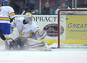 Lake Superior State goaltender Pat Inglis watches as a shot from Notre Dame's Calle Ridderwall (not pictured) goes into the net during Friday nights game in Sault Ste. Marie.