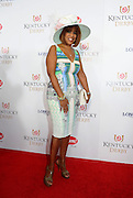 Gayle King walks the Kentucky Derby Red Carpet, Saturday, May 3, 2014, in Louisville, Ky. Longines, the Swiss watchmaker known for its famous timepieces, is the Official Watch and Timekeeper of the 140th annual Kentucky Derby. (Photo by Diane Bondareff/Invision for Longines/AP Images)
