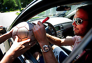 Dutch international football player Joris Mathijsen  gives signatures on as he arrives for the trainingcamp of the Netherlands national football team in Hoenderloo on May 28, 2012. AFP PHOTO/ ROBIN UTRECHT