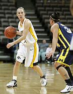 08 February 2007: Iowa guard Kristi Smith (11) is guarded by Michigan guard Jessica Minnfield (34) in Iowa's 66-49 win over Michigan at Carver-Hawkeye Arena in Iowa City, Iowa on February 8, 2007.