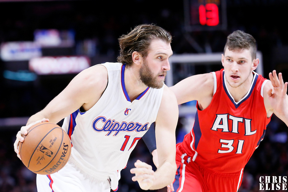 05 January 2014: Los Angeles Clippers forward Spencer Hawes (10) drives past Atlanta Hawks forward Mike Muscala (31) during the Atlanta Hawks 107-98 victory over the Los Angeles Clippers, at the Staples Center, Los Angeles, California, USA.
