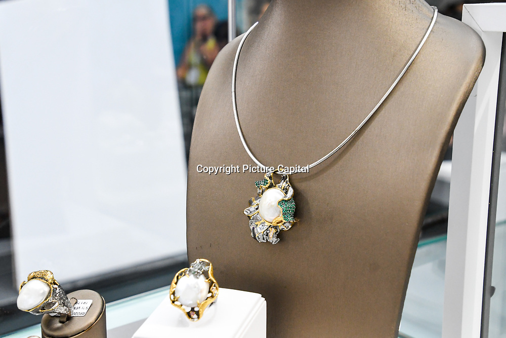 London, UK. 3rd September, 2018. Chen Ma Fine Jewellery of Jersey Gems exhibition at the International Jewellery London 2018, Olympia London, UK.