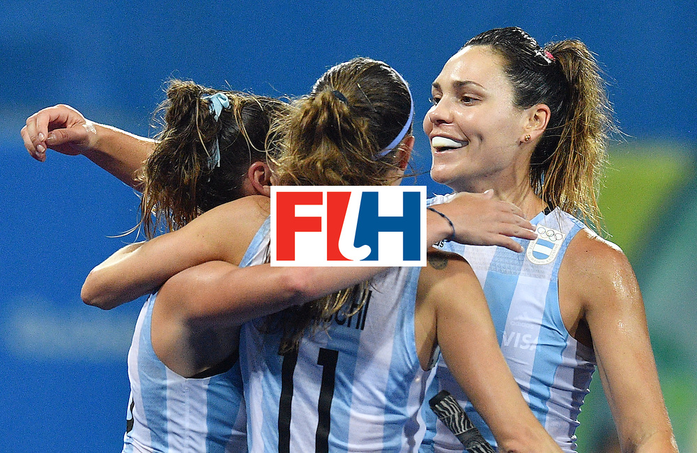 Argentina's Maria Noel Barrionuevo (R) celebrates a goal during the women's quarterfinal field hockey Netherland vs Argentina match of the Rio 2016 Olympics Games at the Olympic Hockey Centre in Rio de Janeiro on August 15, 2016.  / AFP / Carl DE SOUZA        (Photo credit should read CARL DE SOUZA/AFP/Getty Images)