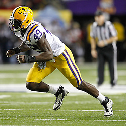 Dec 3, 2011; Atlanta, GA, USA; LSU Tigers defensive end Barkevious Mingo (49) against the Georgia Bulldogs during the second half of the 2011 SEC championship game at the Georgia Dome.  Mandatory Credit: Derick E. Hingle-US PRESSWIRE