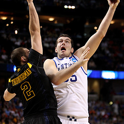 Mar 19, 2011; Tampa, FL, USA; Kentucky Wildcats forward Josh Harrellson (55) shoots over West Virginia Mountaineers forward Cam Thoroughman (2) during the second half of the third round of the 2011 NCAA men's basketball tournament at the St. Pete Times Forum. Kentucky defeated West Virginia 71-64.  Mandatory Credit: Derick E. Hingle